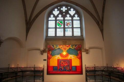 Glass window inside Grote of St. Bavokerk in Haarlem, Netherlands