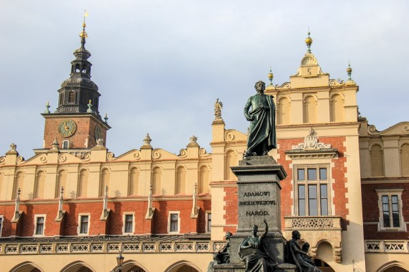 Adam Mickiewicz Monument and Cloth Hall on Main Square in Krakow, Poland