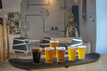 Paddleboard of beer at Miejscowka Bar in Podgorze in Krakow, Poland