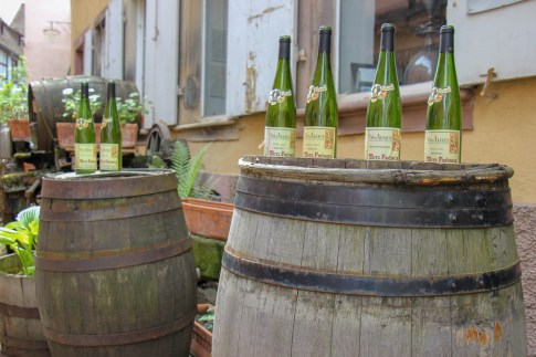Alsace Wine Bottles on barrel in Ribeauville, France