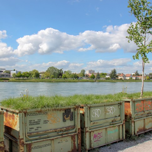 Recycled container potters on Rhine River Walk in Basel, Switzerland