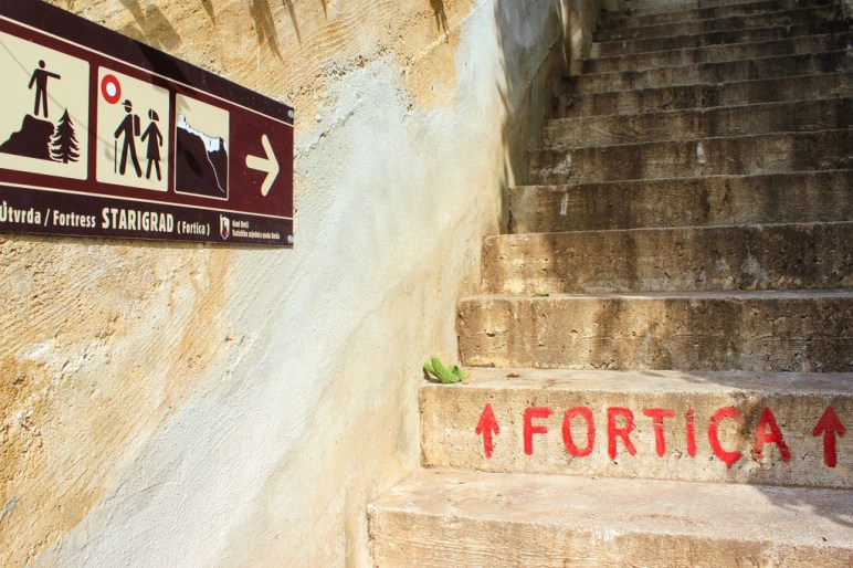 Sign posted stairs to the fortress, Omis, Croatia