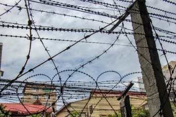 Barbed wire surrounds S21 Museum in Phnom Penh, Cambodia