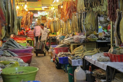 Stalls sell hanging, dried fish at Orussey Market in Phnom Penh, Cambodia