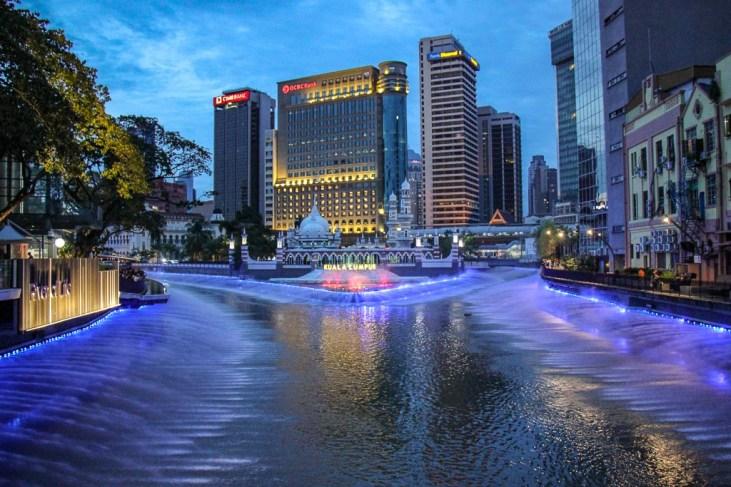 Klang River lightshow and Jamek Mosque in Kuala Lumpur, Malaysia