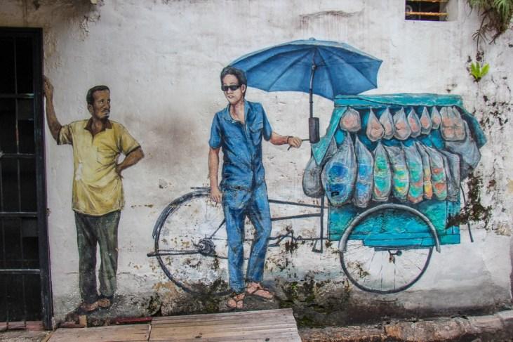Man with food cart street art mural in Geroge Town, Penang, Malaysia
