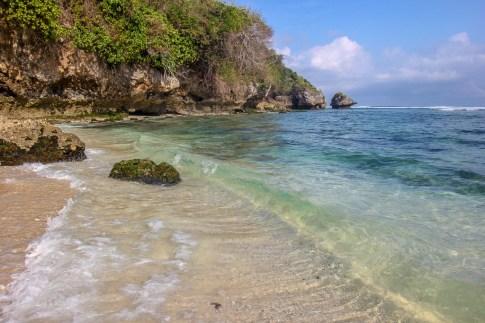 Crystal clear water at Padang-Padang Thomas Beach in Uluwatu, Bali, Indonesia