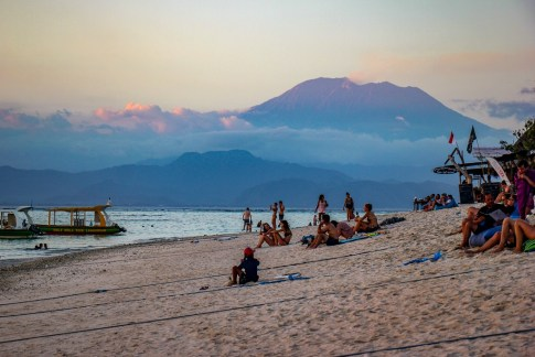 Beach view at sunset with Mount Agung volcano in background on Nusa Lembongan, Bali, Indonesia