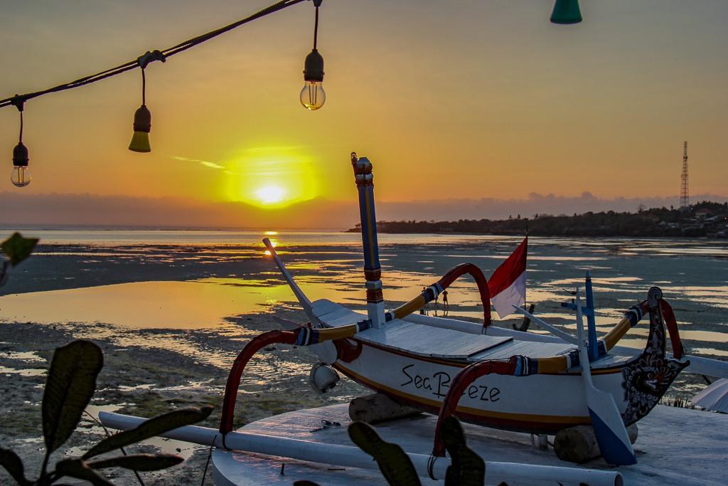 Fiery sunset from Sea Breeze Bar on Nusa Ceningan, Bali, Indonesia