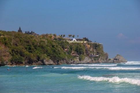 Waves crash in front of Uluwatu Cliff in Uluwatu, Bali, Indonesia