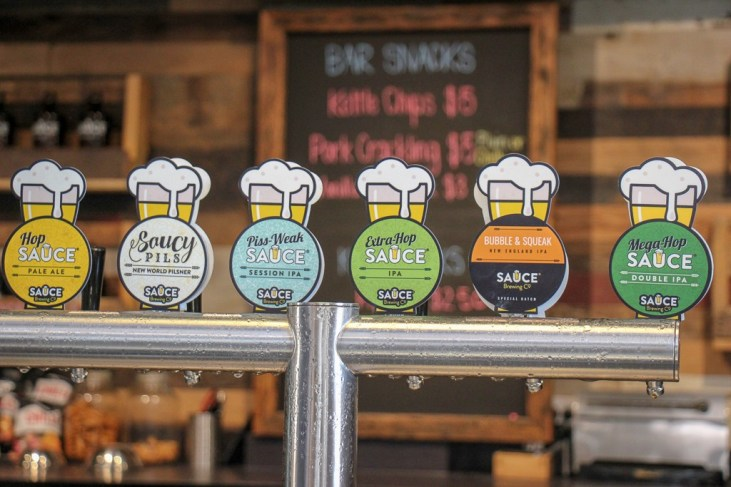 Beer taps at Sauce Brewery in Marrickville, Sydney, Australia