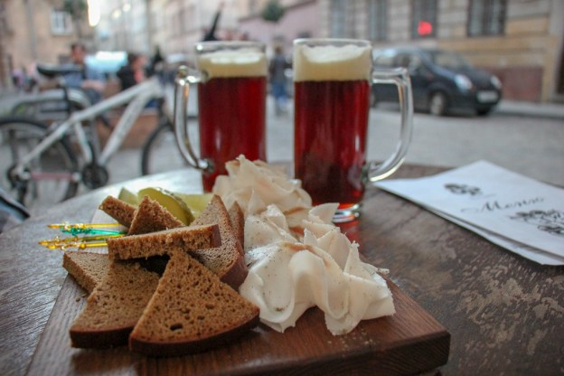Salo (sliced fatback) with bread and beer at Facet in Lviv, Ukraine