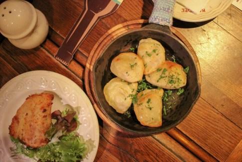 Pan-fried dumplings and fried cutlet at Kumpel Brewery in Lviv, Ukraine
