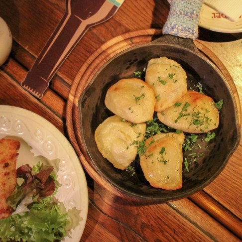Pan-fried dumplings and fried cutlet at Kumpel Brewery in Lviv, Ukraine