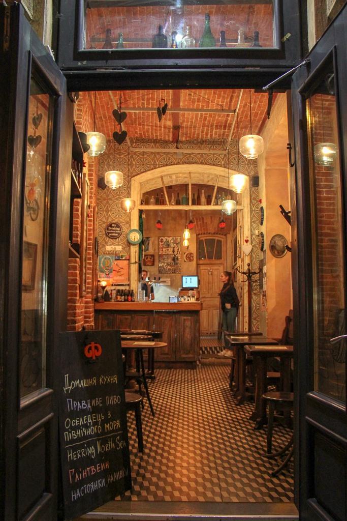 Cozy, brick-wall interior of Facet Restaurant in Lviv, Ukraine