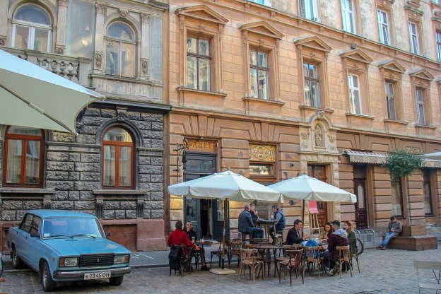 Facet restaurant patrons eating al fresco in Lviv, Ukraine
