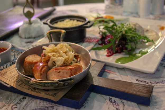 Sausage served in skillet at Baczewski Restaurant in Lviv, Ukraine