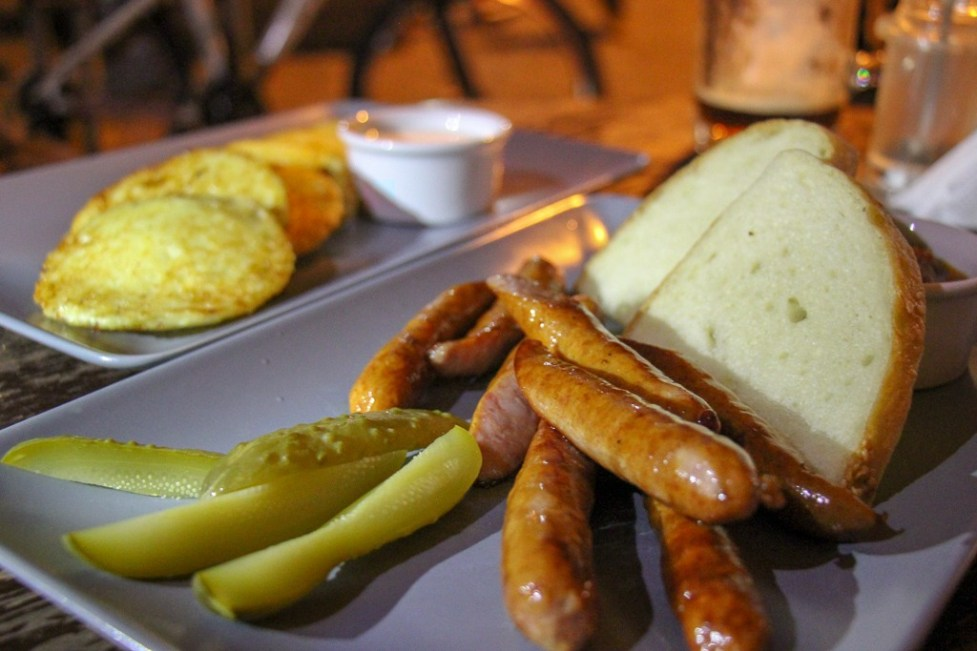 Plate of sausages with pickles and bread at Facet in Old Town, Lviv, Ukraine