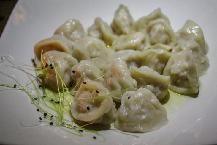 Plate of steamed meat dumplings at Ukrainian Yard restaurants in Lviv, Ukraine