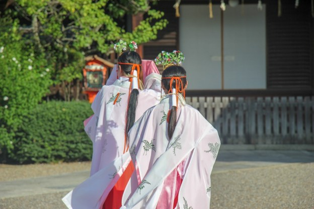 Women in traditional dresses at Yasaka Shrine in Kyoto, Japan