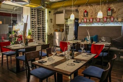 Seating and wine rack at Articok Restaurant in Split, Croatia