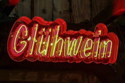 Neon Gluhwein sign at Christmas Market booth in Frankfurt, Germany