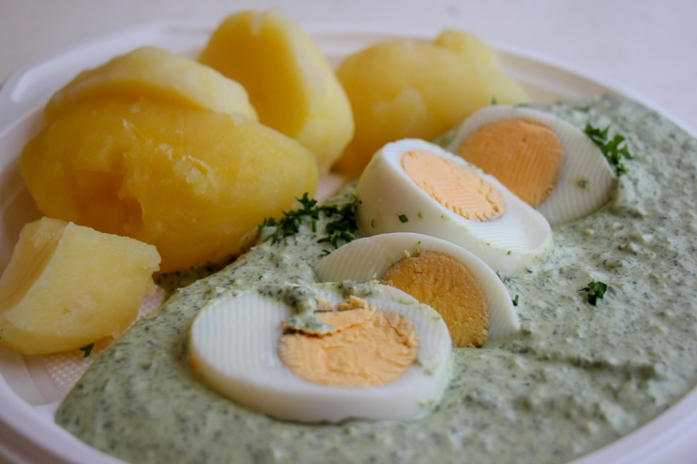 Famous Green Sauce with hard-boiled egg and hot potatoes in Frankfurt, Germany