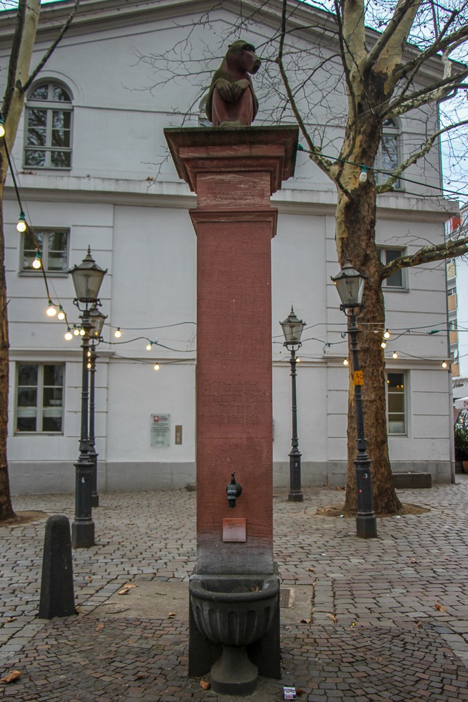 Historic water fountain in Old Sachsenhausen district in Frankfurt, Germany
