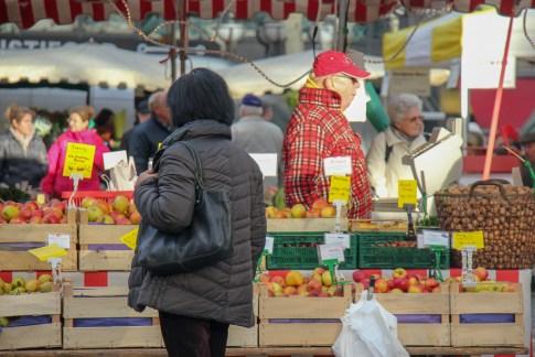 Shopper looks at prodcue at Bauernmarkt Konstablerwache market in Frankfurt, Germany