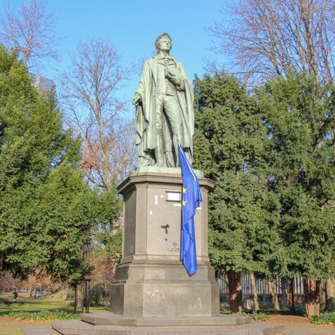 Statue of German poet, Schiller, in greenbelt park in Frankfurt, Germany