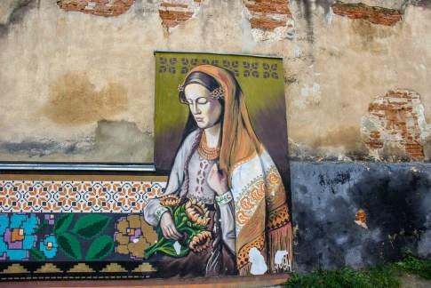 Mural artwork decorates old buildings in Lviv, Ukraine