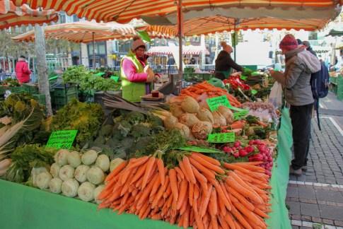 Produce vendor selling vegetables at Bauernmarkt Konstablerwache market in Frankfurt, Germany