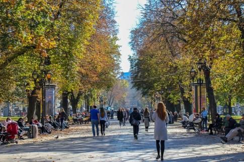 People strolling on the Opera House park promenade in Lviv, Ukraine