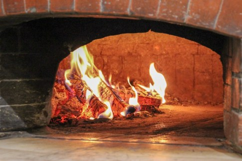 Wood-burning pizza oven at Galija Pizzeria in Split, Croatia