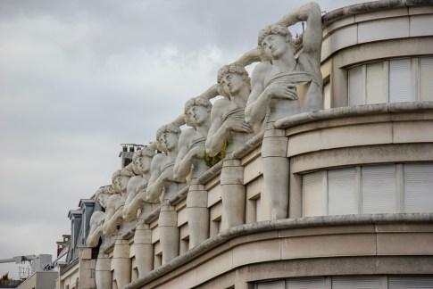 Statues part of building architecture in Paris, France