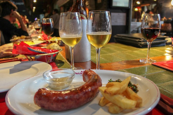 Grilled sausage and fries at Mercado del Puerto in Montevideo, Uruguay