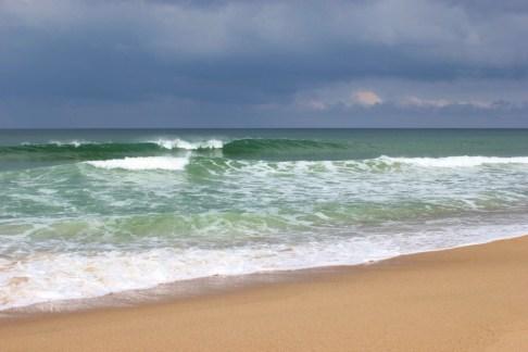 Waves crash on Playa Grande in Punta del Diablo, Uruguay