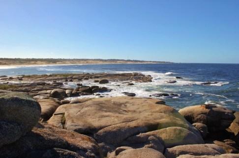 Waves crash on rocks in Punta del Diablo, Uruguay