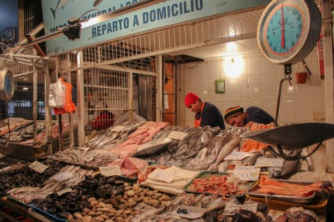 Vendors sell fresh fish at market in Santiago, Chile
