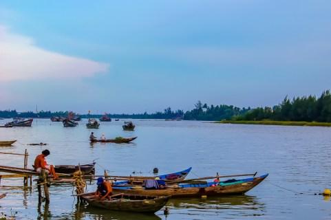 Fishermen in boats on Thu Bon River in Hoi An, Vietnam