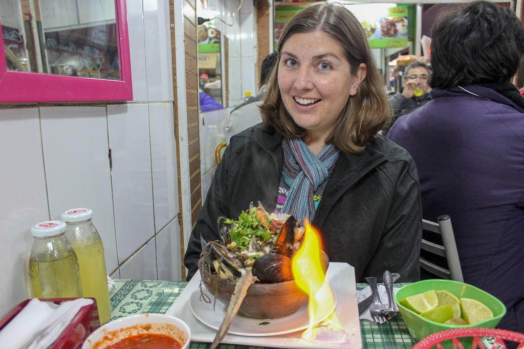 Flaming seafood stew at Mercado La Vega Chica in Santiago, Chile
