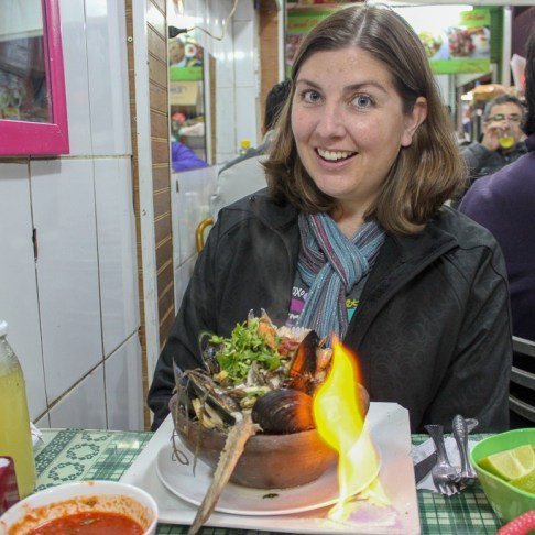 Flaming seafood stew at Mercado La Vega Chica in Santiago, Chile