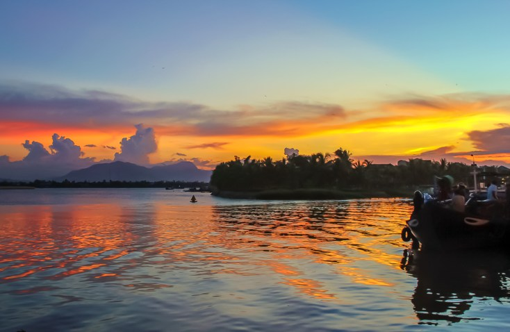 Sunset on Thu Bon River in Hoi An, Vietnam