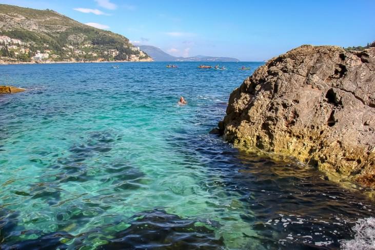 Man swimming outside city walls in Dubrovnik, Croatia