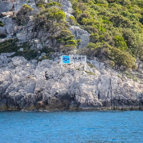 Mljet NP sign on shoreline of Mljet Island, Croatia