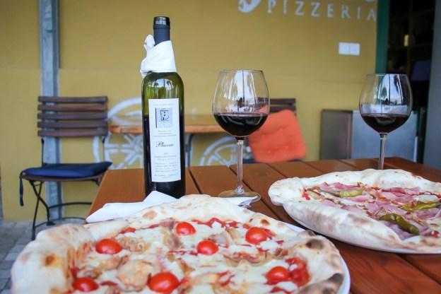 Pizza and wine at Pizzeria Karijola on Vis Island, Croatia