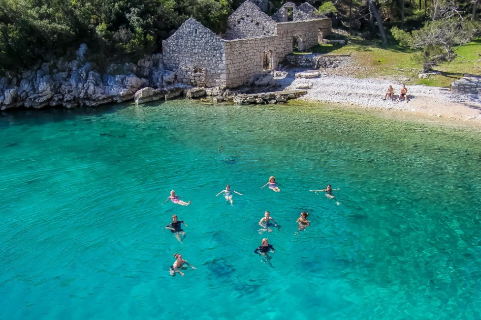 Passengers swimming in cave on Hvar Island, Croatia