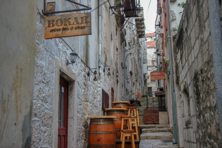 Wine barrel tables at Bokar Wine Bar in Old Town, Korcula Island, Croatia