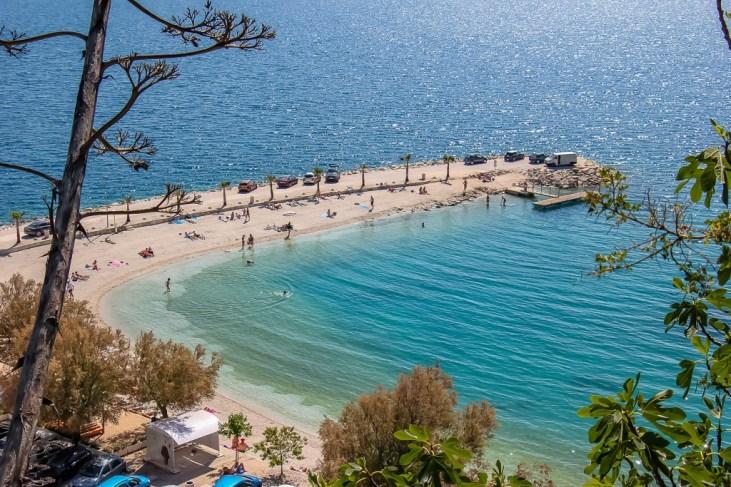 Teal bay at Kasjuni Beach in Split, Croatia