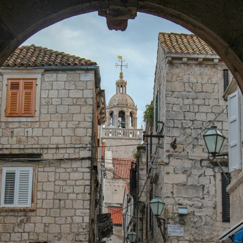 St. Mark's Bell Tower through Revelin Tower arch in Old Town on Korcula Island, Croatia